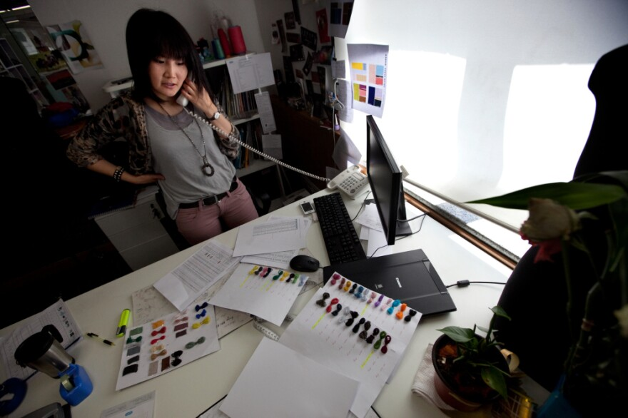 Clothing designer Ariunaa Suri works in her office at the Gobi cashmere company in Ulan Bator. Before mining, cashmere was Mongolia's main export.