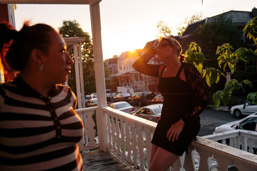 Kiara Campos (left), 25, originally from El Salvador, and Kiera Atkins, 40, smoke on the porch of a transitional group home for transgender adults who are trying to get on their feet.