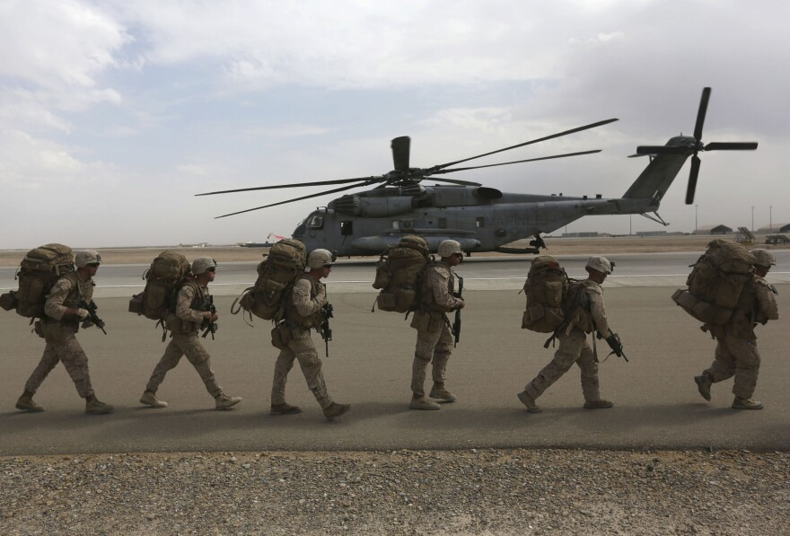 Marines prepare to depart upon the end of operations for Marines and British combat troops in Helmand province. A fleet of planes and helicopters airlifted the last U.S. and British forces from a key base in southern Afghanistan on Monday, a day after the international coalition closed the massive facility and handed it over to the Afghan military.