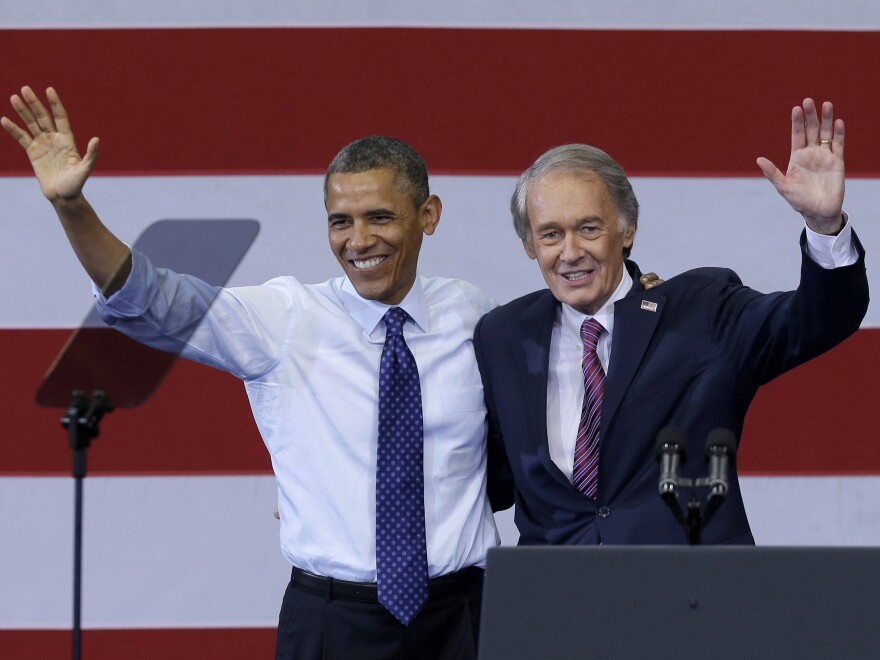President Obama and now-Sen. Ed Markey, D-Mass., wave during a campaign rally for Markey in Boston's Roxbury neighborhood on June 12.