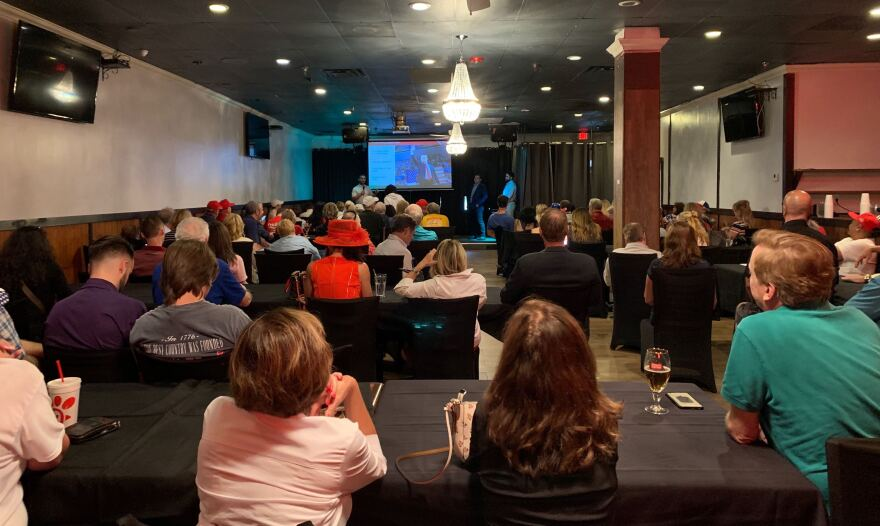Volunteers gathered in a banquet room at a Brazilian steakhouse the night before the rally for a training session organized by the Trump campaign and RNC. It was one of more than 1,000 such sessions nationwide last week.