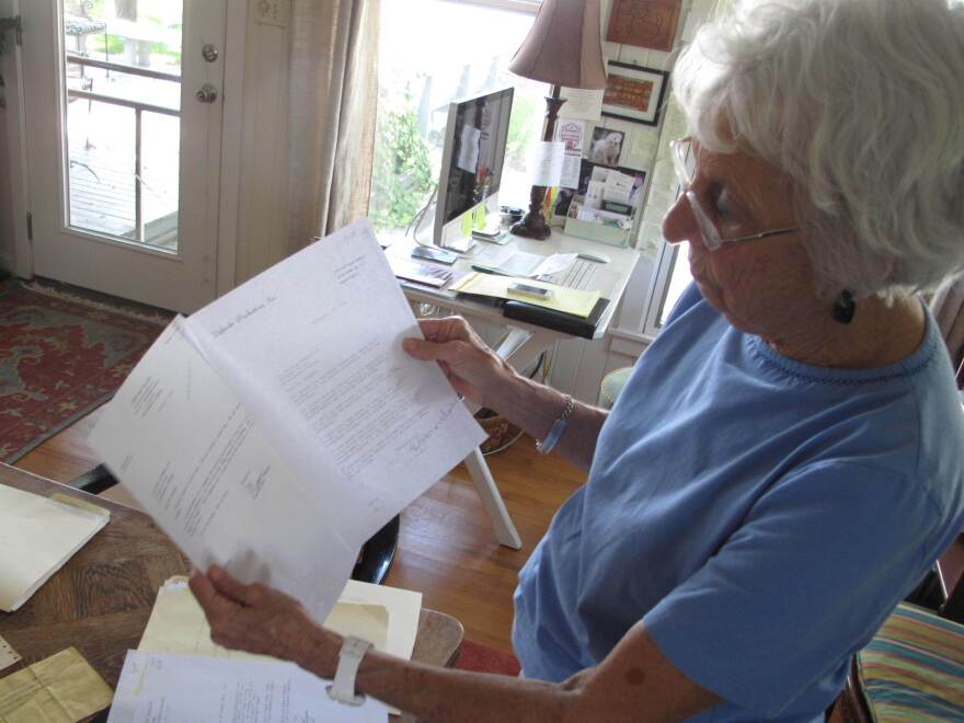 Camille Morgan holds threatening letters her husband received after he criticized Birmingham's white community in the wake of the bombings. Shortly after, Chuck Morgan and his family was forced to flee the city.