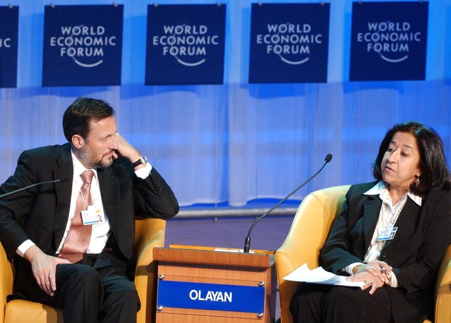 Lubna Olayan speaks, alongside then-CEO of pharmaceutical company Novartis, Daniel Vasella, during the 2005 World Economic Forum in Davos, Switzerland.