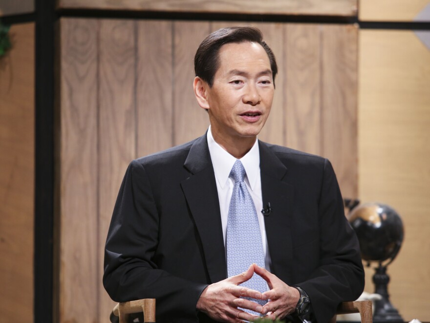 Executive Council convener Bernard Chan, pictured on an RTHK program in 2017, says he has urged the territory's government to reevaluate the situation.