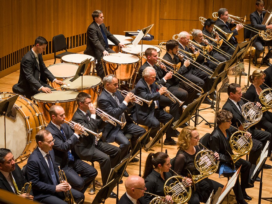 The Baltimore Symphony Orchestra, along with amateur musicians from Academy Week, perform on stage.