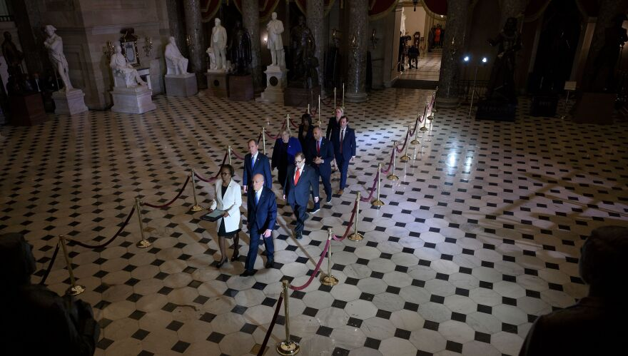 House managers walk to the Senate to deliver the articles of impeachment against President Trump on Capitol Hill on Wednesday.