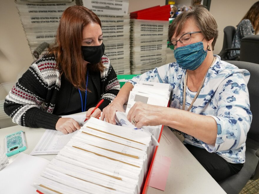 Lehigh County workers count ballots for the general election on Thursday in Allentown, Pa.