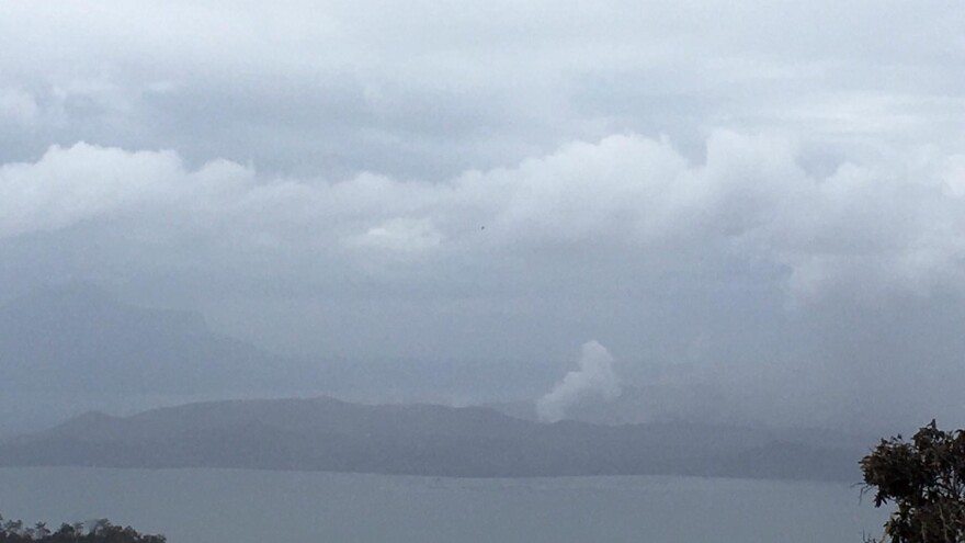 Plumes of steam and gas are visible from across Taal Lake caldera on Wednesday.