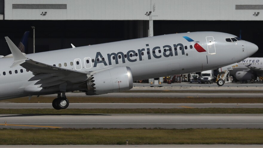 American Airlines Flight 718, a Boeing 737 Max, takes off from Miami International Airport on its way to New York on Thursday — the plane's first commercial flight in the U.S. since it was allowed to return to service. The 737 Max was grounded worldwide after two crashes due to a faulty flight system.