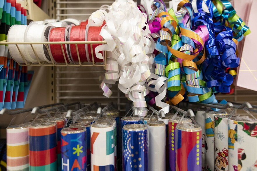 Ribbons and wrapping paper on display in a store.