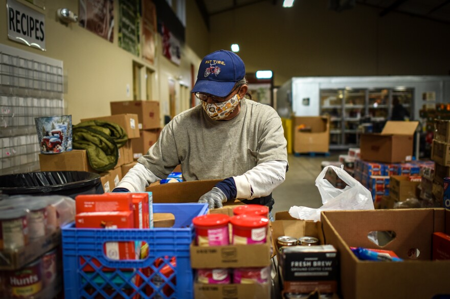Ruben Marez prepares an assortment of snack items for one day of distribution at the Food Bank for Larimer County's Loveland location.