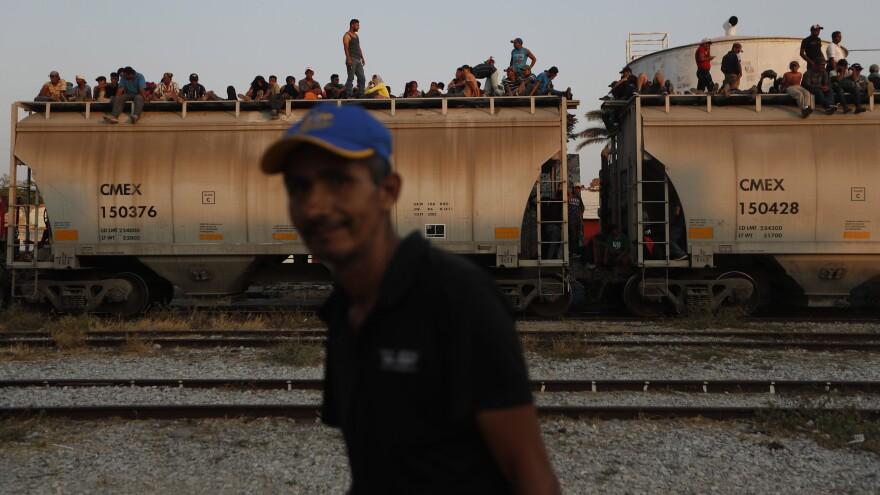 In Ixtepec, Mexico, Central American migrants ride a freight train on their way to the U.S.-Mexico border on April 23.