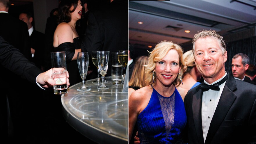 Party-goers leave empty glasses (left) toward the end of a pre-party and Sen. Rand Paul and his wife (right) at a pre-party on Saturday.