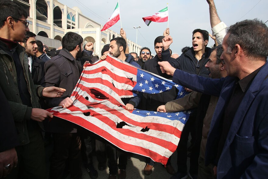 Iranians tear up a U.S. flag during a demonstration in Tehran on January 3, 2020 following the killing of Iranian Revolutionary Guards Major General Qasem Soleimani in a US strike on his convoy at Baghdad international airport. (ATTA KENARE/AFP via Getty Images)