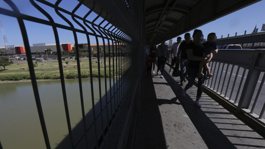People walk across International Bridge 1 Las Americas, a legal port of entry that connects Laredo, Texas, in the U.S. with Nuevo Laredo, Mexico.