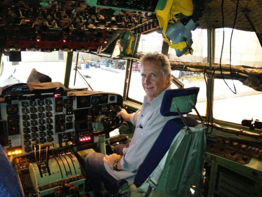 """Gill sits in a C-130 cockpit before the testing phase for <em>Furious 7</em> stunts. In his career, he's broken 23 bones, punctured a lung, lost part of a finger. But, """"I gotta say, I feel fine,"""" he says."""