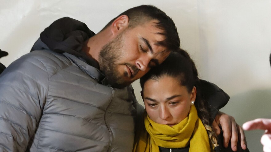 José Roselló and Victoria Garcia take part in a vigil last Thursday for their son, Julen, whose body was found over the weekend in a borehole in Spain's Málaga province.