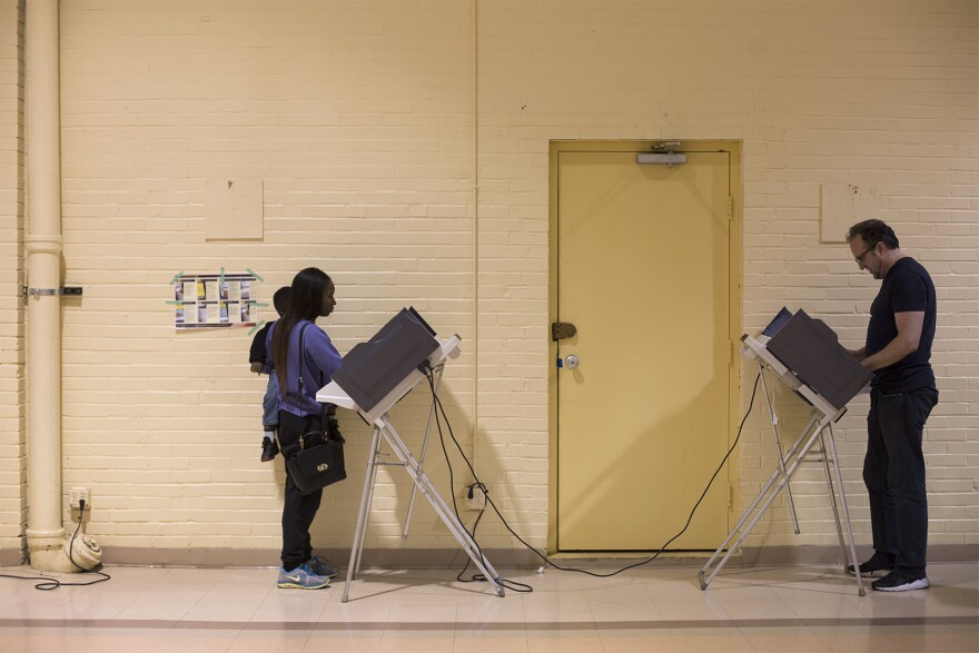 Voters cast electronic ballots at Central Baptist Church in St. Louis on Nov. 8, 2016.