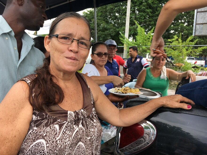 """""""It gives us lots of joy and happiness to cook ... for them,"""" says Deborah Jiménez, who leads the volunteer cooking crew."""