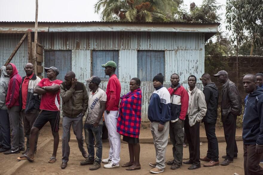 People gather to vote at Olympic Primary School in the Kibera neighborhood of Nairobi, Kenya on Tuesday.