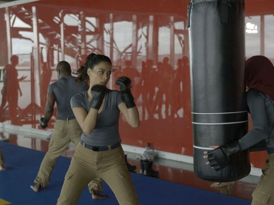 Twin sisters Nimah and Raina Amin work out in a scene from <em>Quantico.</em>
