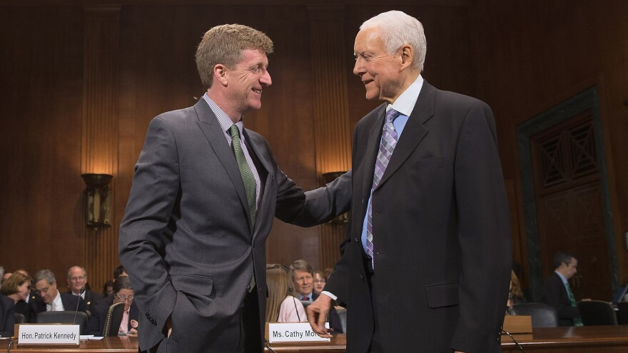 Former Rep. Patrick Kennedy (left) is welcomed by Sen. Orrin Hatch, R-Utah, during a hearing about mental health parity rules Thursday. A new rule issued by the Obama administration aims to increase parity for how insurers handle mental health issues.