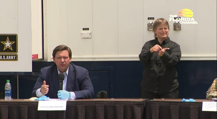 Governor Ron DeSantis, left, addresses media Wednesday, April 8, 2020