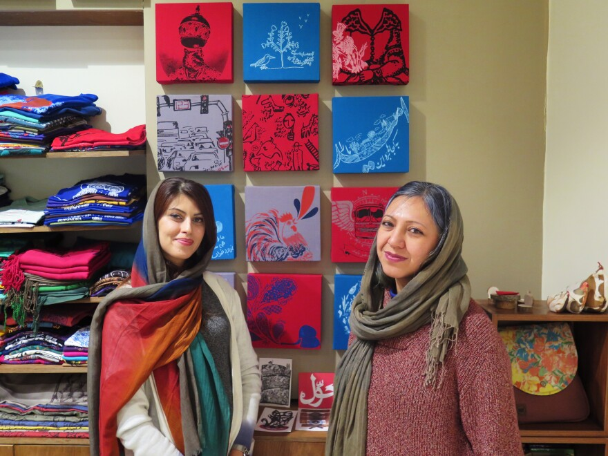 Sara Noghani (left) and Pooya Shahsiah are co-owners of a Tehran shop. Noghani is weighing an opportunity to reside in Australia but wants to give things in Iran a fair chance.