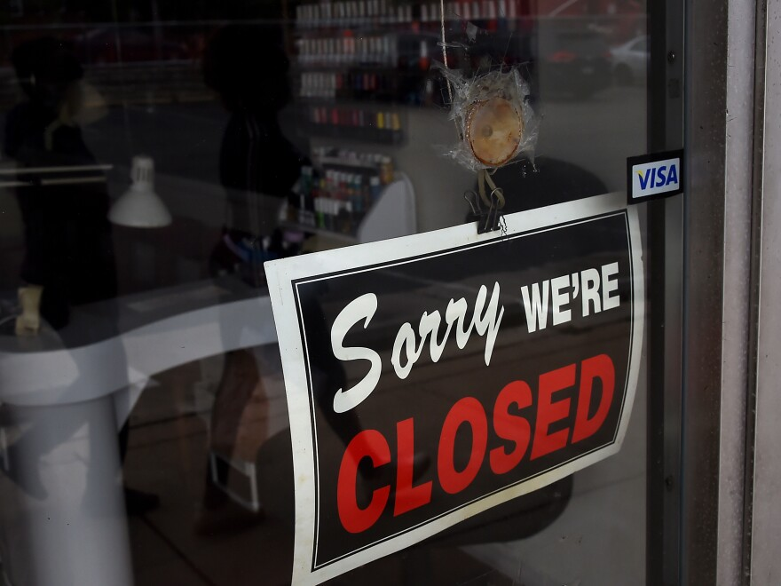 Many businesses — including this nail salon in Arlington, Va. — remain closed during shelter-in-place lockdowns across the country.
