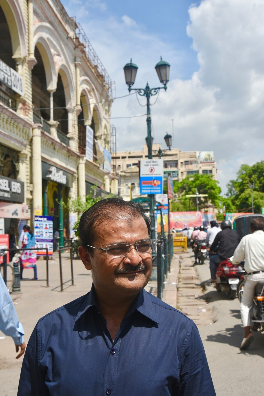 Arif Jafar stands in Lucknow's Hazratganj traffic circle, where police beat him 17 years ago. Jafar was arrested for handing out condoms to gay men.