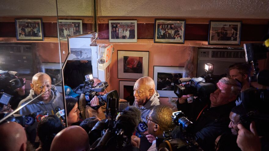 Reporters surround Cosby at the LaRose Jazz Club on Monday night. Cosby's representatives invited the media to the performance just two hours before it started.