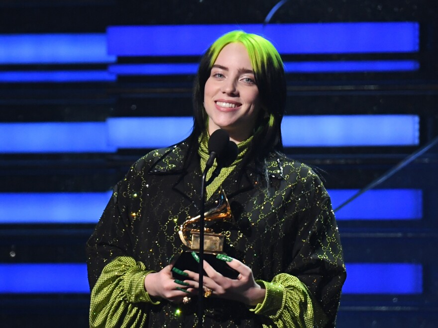 "Billie Eilish, who swept the four major categories at the 2020 Grammy Awards, accepts her trophy for Song of the Year, for ""Bad Guy."""