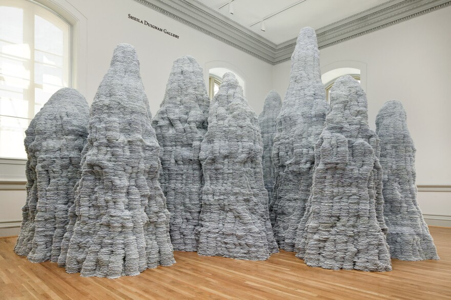 """You may have <em>thought</em> you used mountains of index cards while working on school research papers, but Tara Donovan shows you what mountains of index cards actually look like in her installation for the """"Wonder"""" exhibit."""