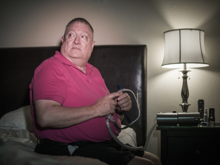 Tony Schmidt, pictured here with his CPAP machine in his home in Carrolton, Texas, was diagnosed with obstructive sleep apnea in 2006. He has to use the machine to get sound sleep. He was shocked to learn that his insurance company had been collecting data from the machine on his sleep patterns.