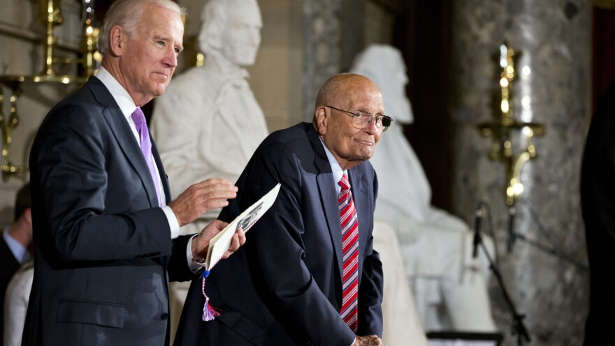 Rep. John Dingell, D-Mich., the longest-serving member of Congress, is celebrated by colleagues, including Vice President Biden, on Capitol Hill in June 2013. A former chairman of the Energy and Commerce Committee, Dingell, now 87, announced in February that he will retire after this term.