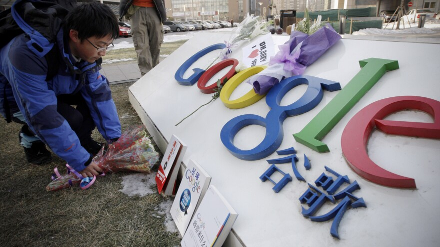 A man places flowers outside Google's Chinese headquarters in Beijing on Jan. 15, 2010. The tech giant's accusation that year that it had been hacked by China cast light on a problem few companies discuss: the pervasive threat from Chinese-based cybertheft.