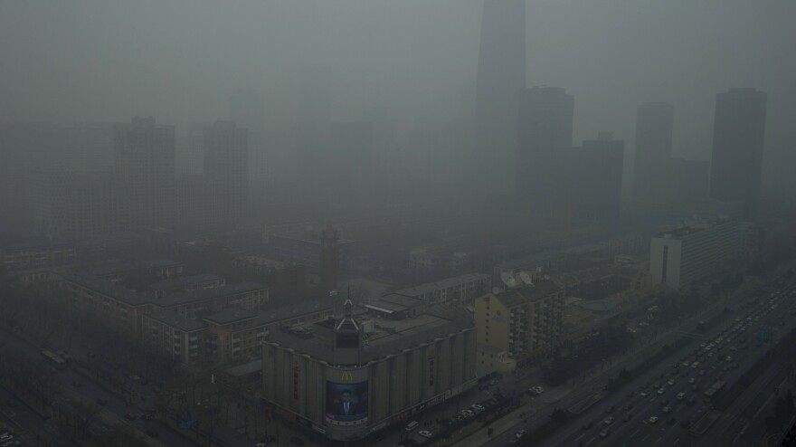Skyscrapers are obscured by heavy haze in Beijing on Jan. 13. Air pollution remains a serious — sometimes overwhelming — problem, but researchers say environmental technology is available to solve it.