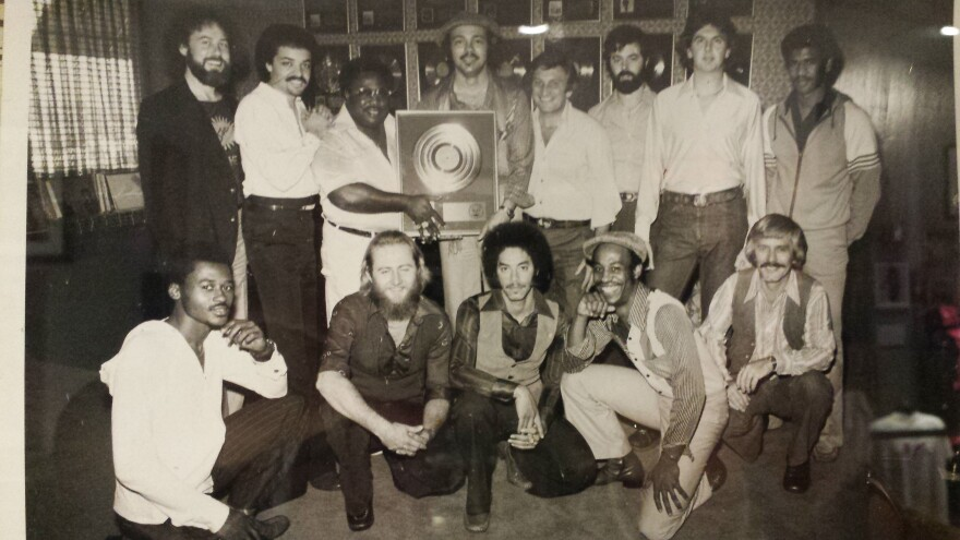 SUN with their gold album Sunburn at Columbia Records. Ernie (then 24) is first row, second from left.