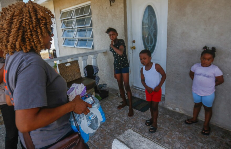 Lana Henfield-Johnson, a nursing informatics specialist at UF Health Shands in Gainesville, Florida, delivers water and other supplies to children displaced from Sweetings Cay due to Hurricane Dorian who are now living in Freeport, Grand Bahama.