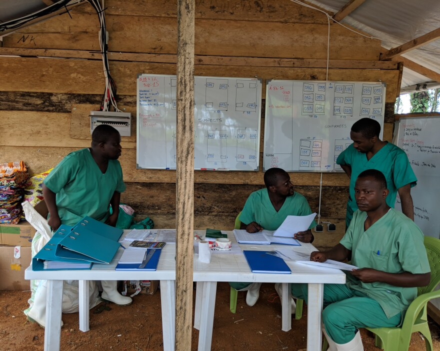 Medical staff working in the low- risk zone of the Ebola treatment center in Mangina.