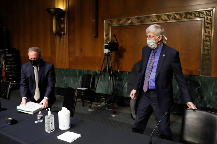 National Institutes of Health Director Dr. Francis Collins, right, received the Templeton Prize for his work to de-escalate mistrust between scientists and people of faith.