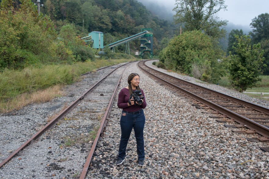 "Reporter Mahlia Posey reports near the Viking Wash Plant in Justiceville, Kentucky as part of The GroundTruth Project's ""Crossing the Divide"" reporting project."