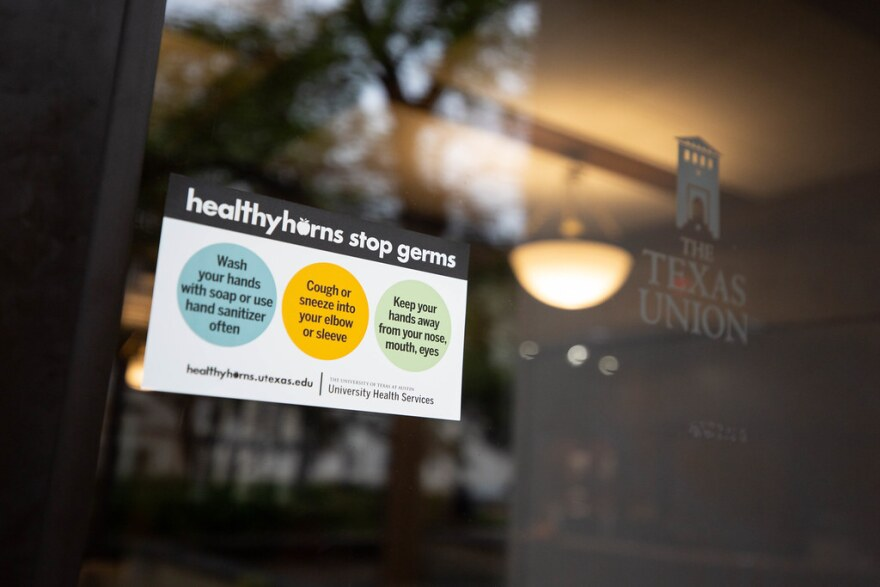 A sign encouraging healthy habits to prevent the spread of disease is posted at UT's student union.