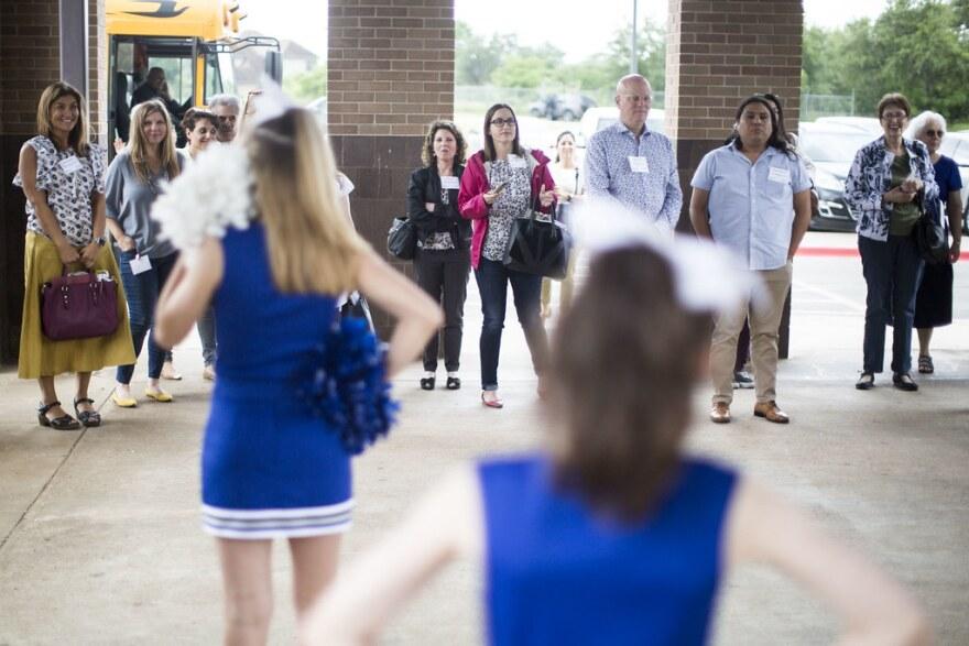 Cheerleaders greet the realtors at Bailey Middle School.