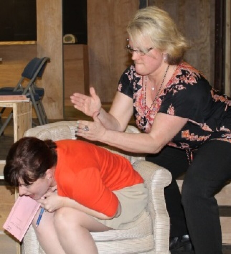 """Olive gives Florence a back massage in """"The Odd Couple"""""""