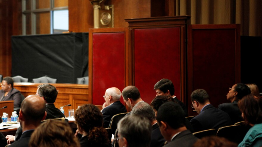 Ex-FBI agent Ali Soufan testifies on Capitol Hill in 2009 from behind a black curtain and a room divider in to protect his identity. Soufan has long argued that he was able to obtain more intelligence from suspects by building rapport than the CIA was by using waterboarding and other harsh methods.