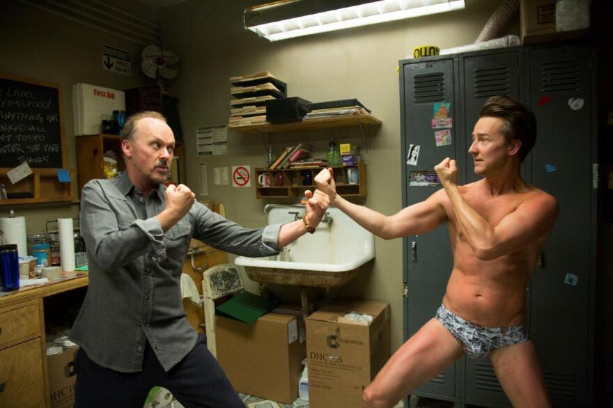 In <em>Birdman,</em> Ed Norton (right) plays a talented but pretentious actor in a Broadway play being directed by an actor he disrespects (Michael Keaton, left) for having starred in a series of <em>Birdman</em> superhero films.