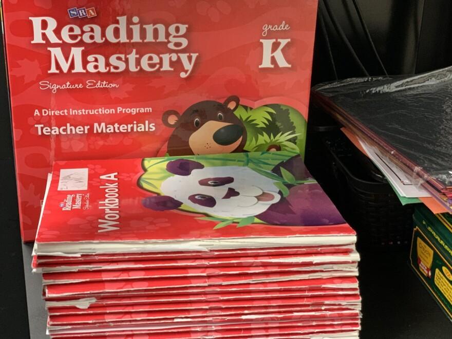 Reading Mastery stack of K level workbooks