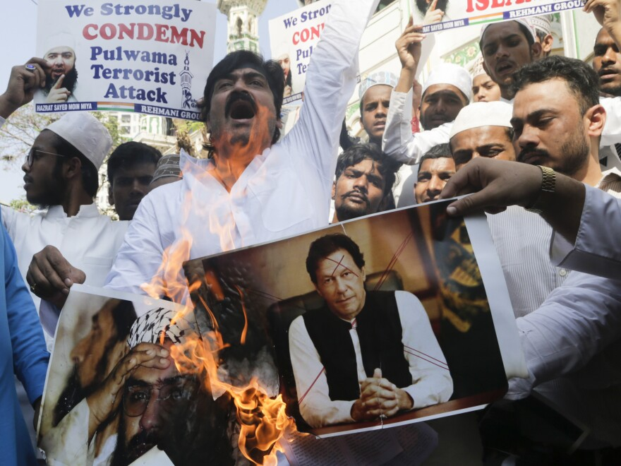 Indian protesters in Mumbai burn posters of Pakistan's Prime Minister Imran Khan during a demonstration against the Feb. 14 attack that killed more than 40 Indian policemen in the Kashmir region.