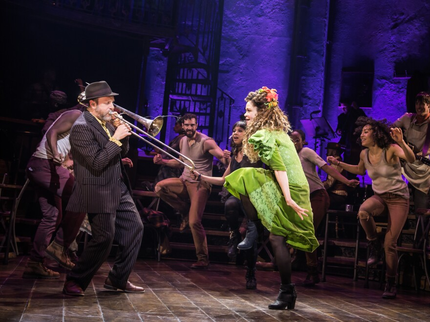 Brian Drye plays trombone with Tony-nominated actress Amber Grey onstage in <em>Hadestown</em>.